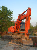 Orange excavator vertical — Stock Photo