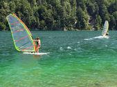 Windsurfers in a mountain lake — Stock Photo