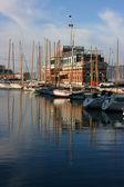 Docked boats in port — Stockfoto
