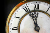 About twelve on old clock face — Stock Photo