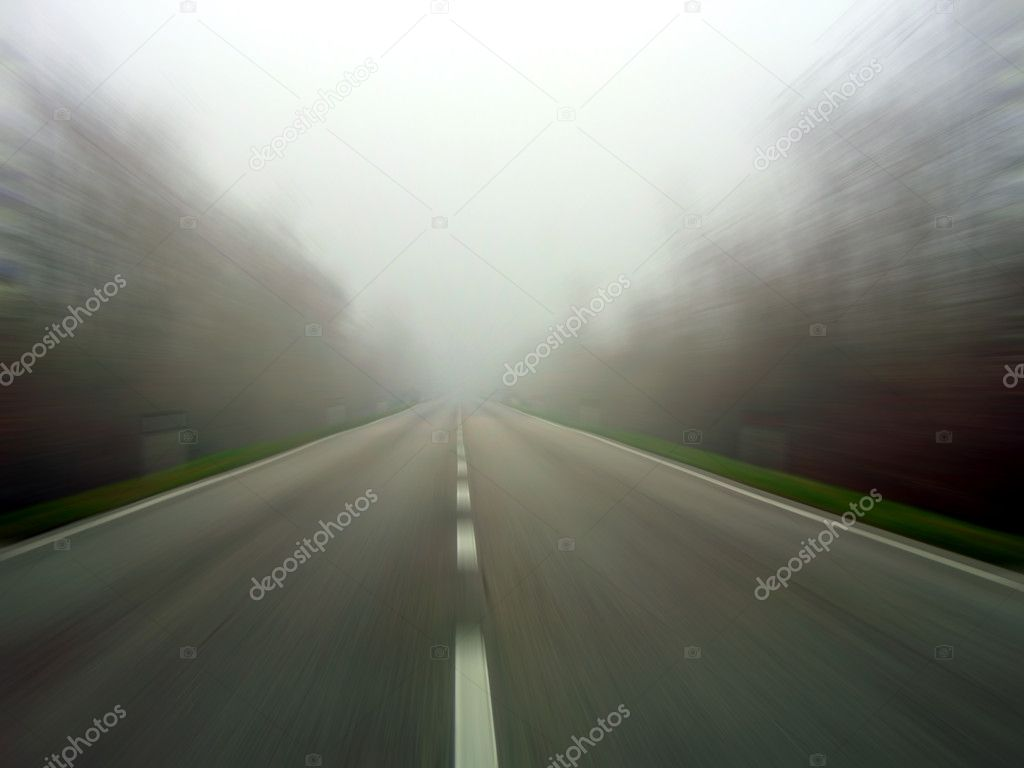 Speeding the middle of a road in the fog. Radial blur — Stock Photo #2472332