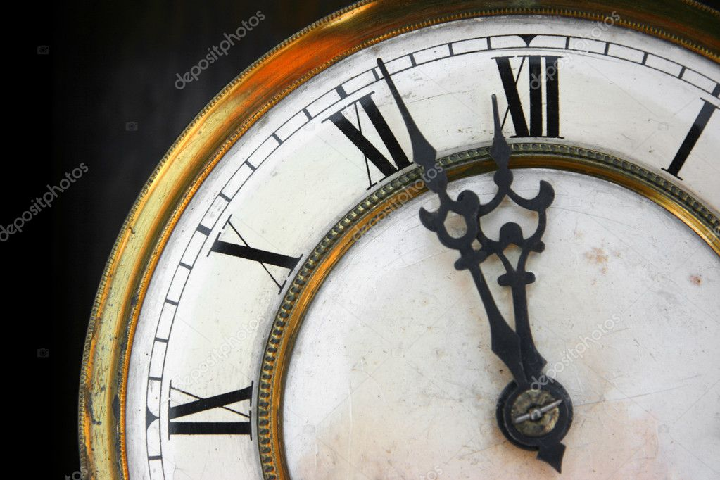 About twelve on old clock face detail, roman numerals  Stock Photo #2475438