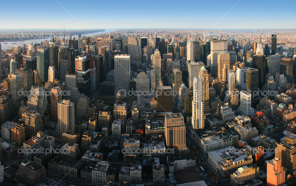 Aerial panoramic view over Manhattan from Empire State building top, New York. Sunset of a clear, sunny day. — Stock Photo #2475738