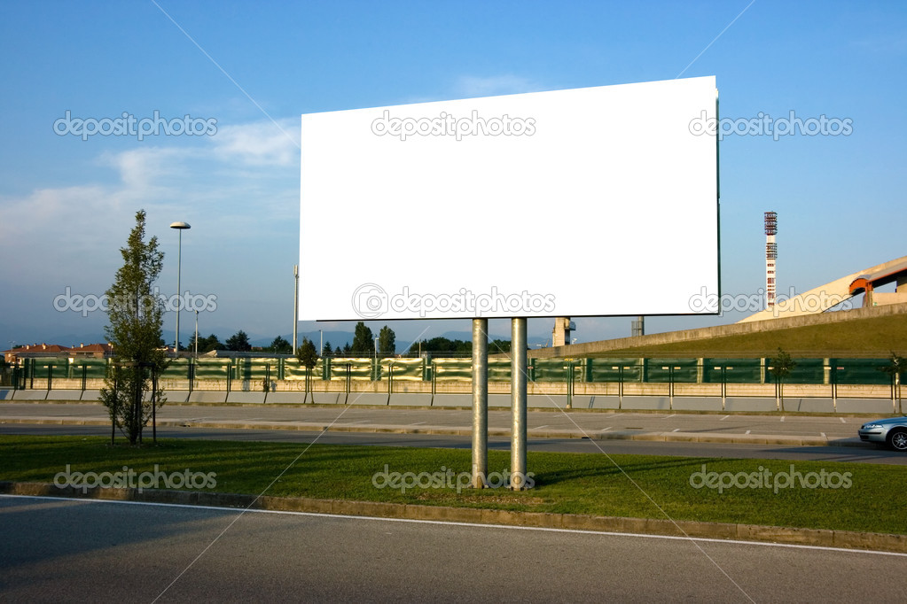 Blank billboard on the street at sunset — Stock Photo #2475913