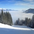 Skiing over the clouds panorama — Stock Photo