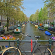 Bike on a bridge in Amsterdam — Stock Photo