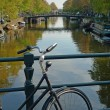 Bike and canal in Amsterdam — Stock Photo