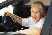 Elderly woman in the car — Stock Photo
