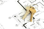 House plan with golden keys. — Stock Photo