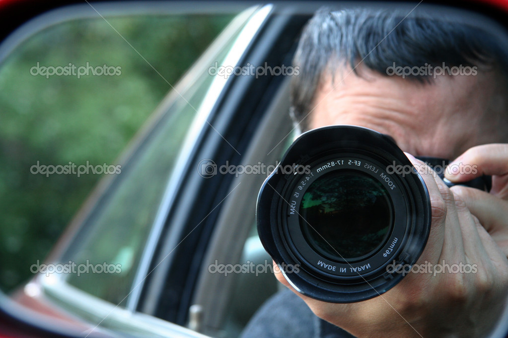 Paparazzi Hiding with Camera — Stock Photo #2285472