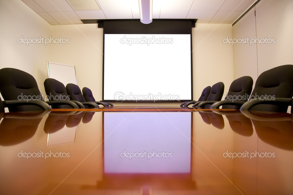 Meeting Room with White Screen Ready for a Presentation  Stock Photo #2285582
