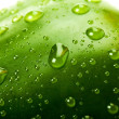 Green bell pepper with water droplets — Stok fotoğraf