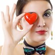 Woman holding a red heart — Stock Photo #2333895