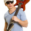 Guitarist with guitar on his shoulder — Stock Photo #2333970