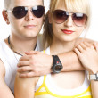 Young casual couple with sunglasses — Stock Photo