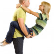 Young man holding his girlfriend — Stock Photo
