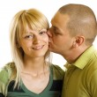 Royalty-Free Stock Photo: Man kisses young woman