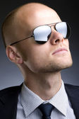 Businessman with sunglasses — Stock Photo