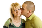 Man kisses young woman — Stock Photo