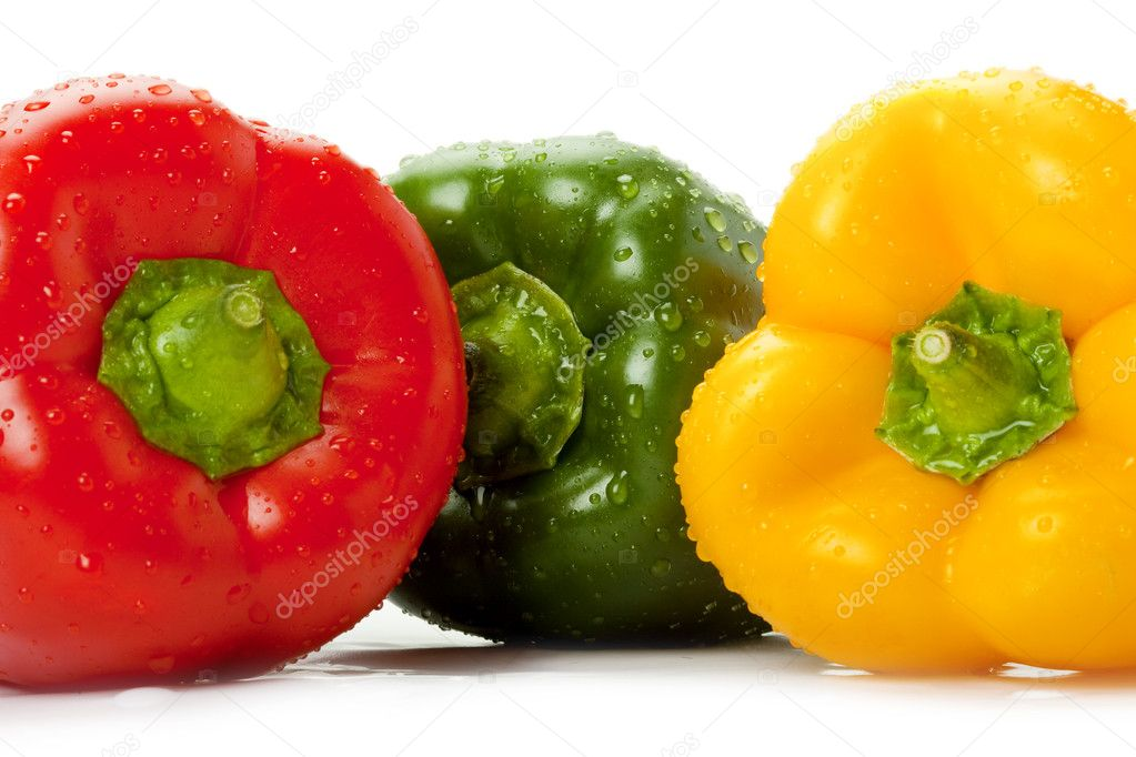 Picture of three colored bell peppers with water droplets on  Stock Photo #2333419