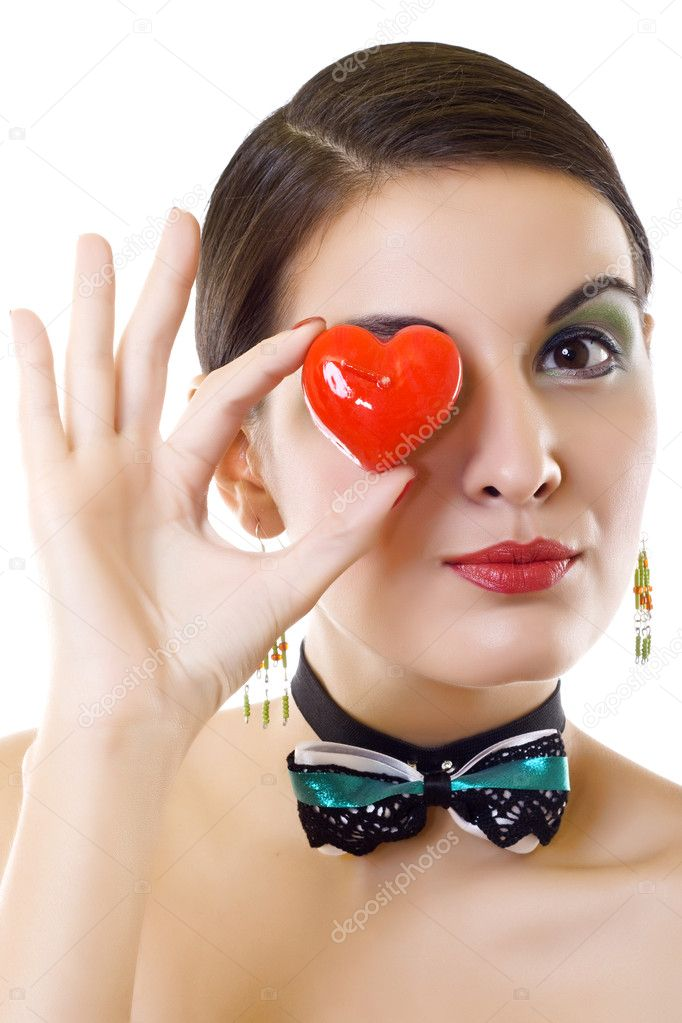 Portrait of a attractive young woman holding a red heart over white background — Stock Photo #2333895