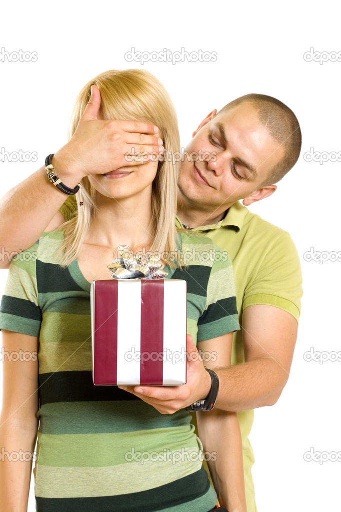 Man surprising a woman with present over white background — Stock Photo #2334150