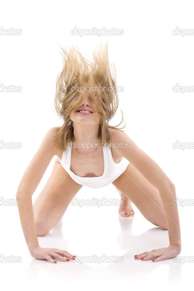 Pretty young woman with fluttering hair on a white background — Stock Photo #2334258