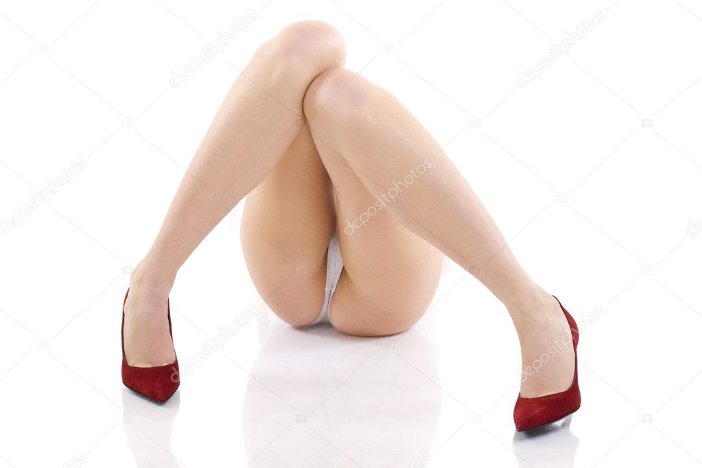 Beautiful legs of the young woman wearing fashion red shoes, isolated on a white background — Stok fotoğraf #2334294