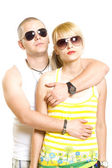 Young trendy couple wearing sunglasses — Stock Photo