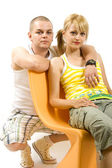 Man and woman on chair — Stock Photo