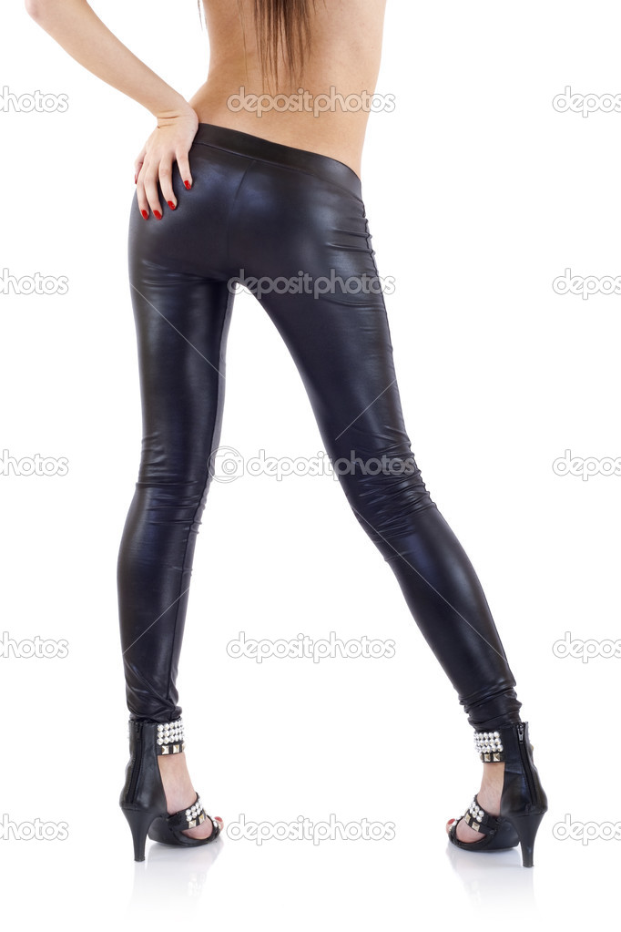 Beautiful woman wearing leather pants standing with her back to the camera — Stock Photo #2620135