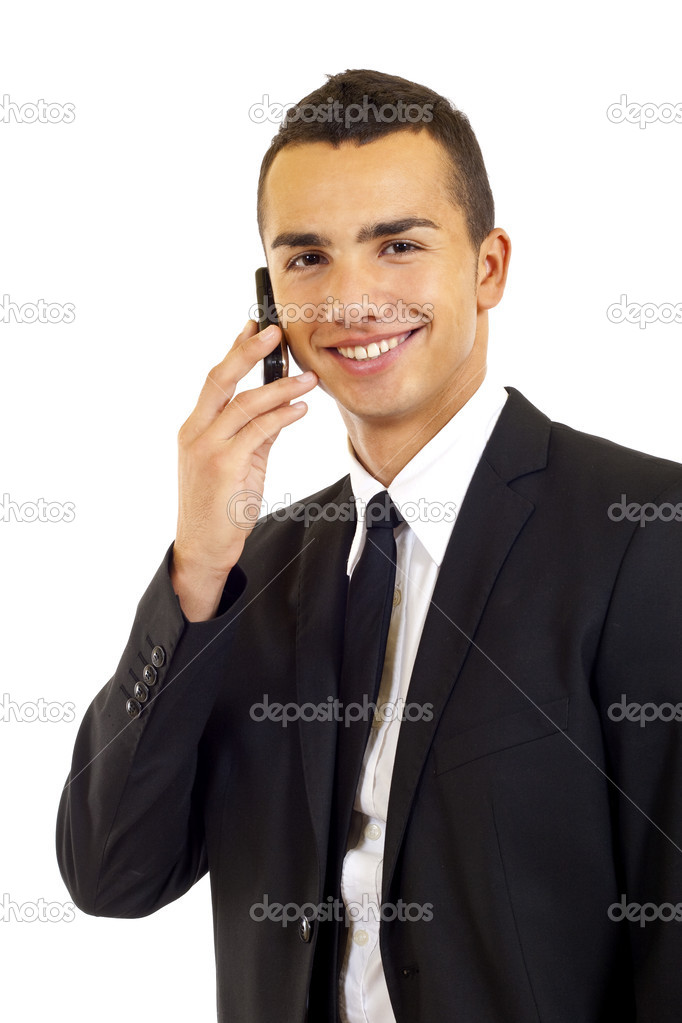 Young smiling businessman talking on mobile isolated on white background — Stock Photo #2620179