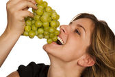 Young woman holding green fruit over white backg — Stock Photo