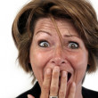 Woman with a surprised face - Stock Photo