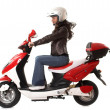 Stock Photo: Womriding scooter