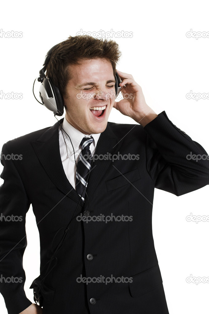 Man listening to music over white background — Stock Photo #2348382