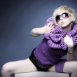 Fashion blond girl in lilac clothes — Stock Photo #2332332