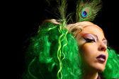 Fashion girl-peacock with green hair — Stock Photo