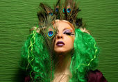 Fashion girl-peacock with green hair — Stock Photo