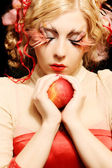 Fashion girl with red apple — Stock Photo