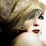 Fashion girl in golden boa — Stock Photo