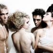 Four fashion models on the white backgro — Stock Photo #2558565