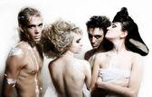 Four fashion models on the white backgro — Stock Photo