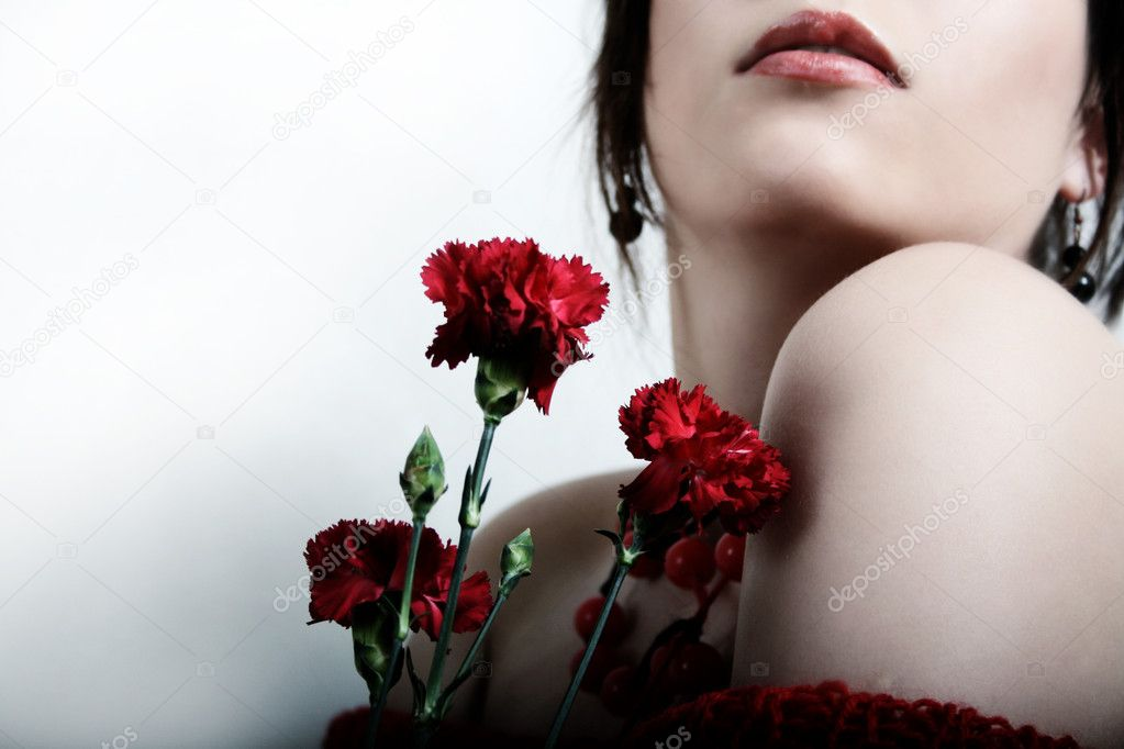 Girls with red flowers — Stock Photo #2558631