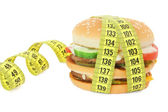 Big sandwich with tape measure — Stock Photo