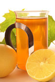 Hot lemon tea with maple leafs — Stock Photo