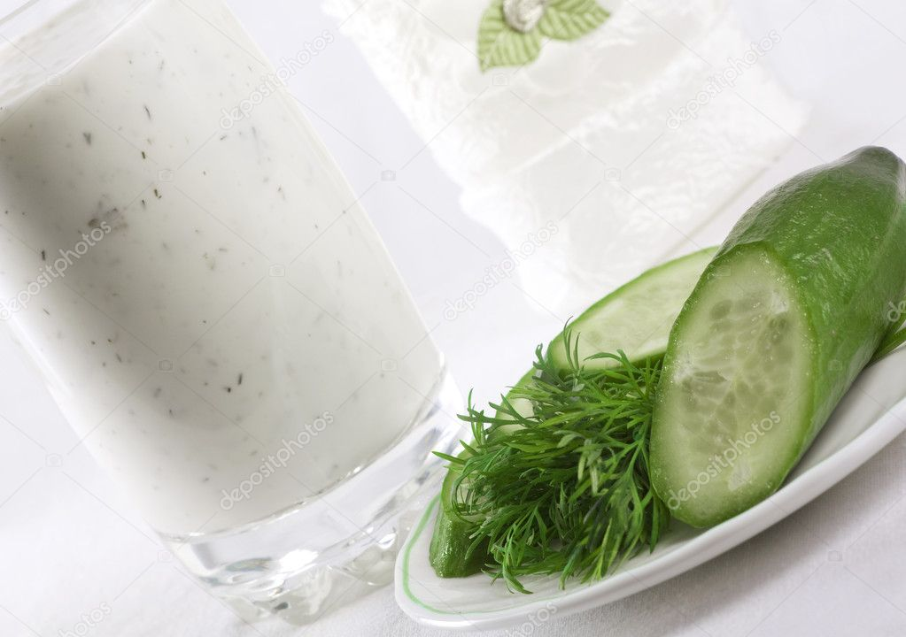 Composition of kefir in the glass with cucumber and dill near on the plate — Stock Photo #2408232