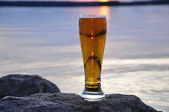 Cold beer on rock — Stock Photo