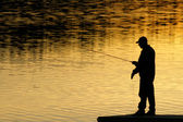 Fishing at sunset — Stock Photo