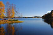 Calm lake reflection in autumn — Stock Photo